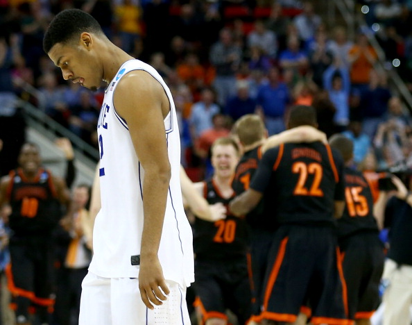 RALEIGH, NC - MARCH 21:  Quinn Cook #2 of the Duke Blue Devils walks off the court after losing to the Mercer Bears 78-71 in the second round of the 2014 NCAA Men's Basketball Tournament at PNC Arena on March 21, 2014 in Raleigh, North Carolina.  (Photo by Streeter Lecka/Getty Images)