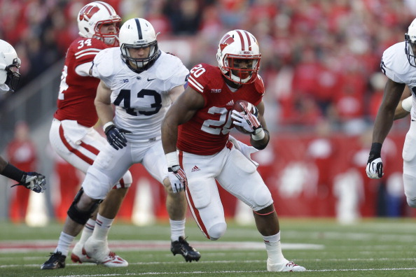 MADISON, WI - NOVEMBER 30: James White #20 of the Wisconsin Badgers runs with the football during the first half of play against the Penn State Nittany Lions at Camp Randall Stadium on November 30, 2013 in Madison, Wisconsin. (Photo by Mike McGinnis/Getty Images)
