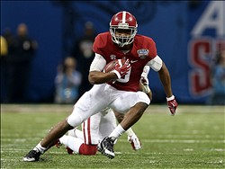 Jan 2, 2014; New Orleans, LA, USA; Alabama Crimson Tide wide receiver Amari Cooper (9) runs after a catch against the Oklahoma Sooners during the first quarter of the Sugar Bowl at the Mercedes-Benz Superdome. Mandatory Credit: Chuck Cook-USA TODAY Sports
