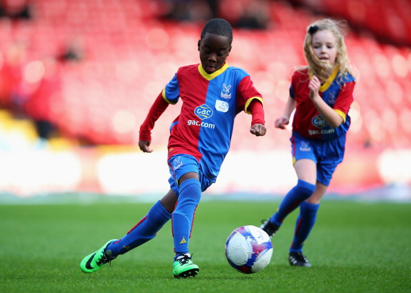 LONDON, ENGLAND - JANUARY 18:  Crystal Palace mascots warm up prior to the Barclays Premier League match between Crystal Palace and Stoke City at Selhurst Park on January 18, 2014 in London, England.  (Photo by Clive Rose/Getty Images)