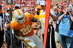 Sep 7, 2013; Knoxville, TN, USA; Tennessee Volunteers running back Rajion Neal (20) runs the val against the Western Kentucky Hilltoppers during the second half at Neyland Stadium. Tennessee won 52-20. Mandatory Credit: Jim Brown-USA TODAY Sports
