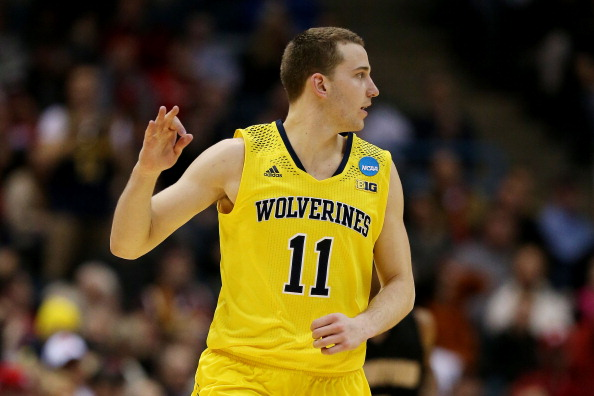 MILWAUKEE, WI - MARCH 20:  Nik Stauskas #11 of the Michigan Wolverines celebrates a three point shot in the second half during the second round of the 2014 NCAA Men's Basketball Tournament at BMO Harris Bradley Center on March 20, 2014 in Milwaukee, Wisconsin.  (Photo by Jonathan Daniel/Getty Images)