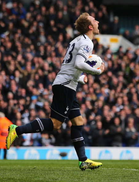 LONDON, ENGLAND - MARCH 23: Christian Eriksen of Tottenham Hotspur celebrates scoring his second goal during the Barclays Premier League match between Tottenham Hotspur and Southampton at White Hart Lane on March 23, 2014 in London, England.  (Photo by Clive Rose/Getty Images)