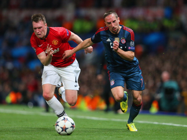 MANCHESTER, ENGLAND - APRIL 01: Phil Jones of Manchester United and Franck Ribery of Bayern Muenchen compete for the ball during the UEFA Champions League Quarter Final first leg match between Manchester United and FC Bayern Muenchen at Old Trafford on April 1, 2014 in Manchester, England.  (Photo by Alex Livesey/Getty Images)
