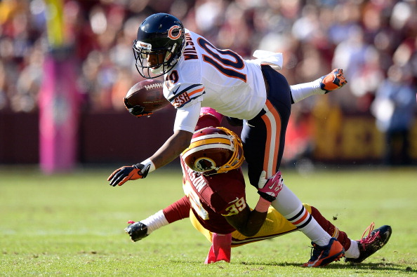 LANDOVER, MD - OCTOBER 20:  Marquess Wilson #10 of the Chicago Bears is tackled by David Amerson #39 of the Washington Redskins in the third quarter during an NFL game at FedExField on October 20, 2013 in Landover, Maryland.  (Photo by Patrick McDermott/Getty Images)