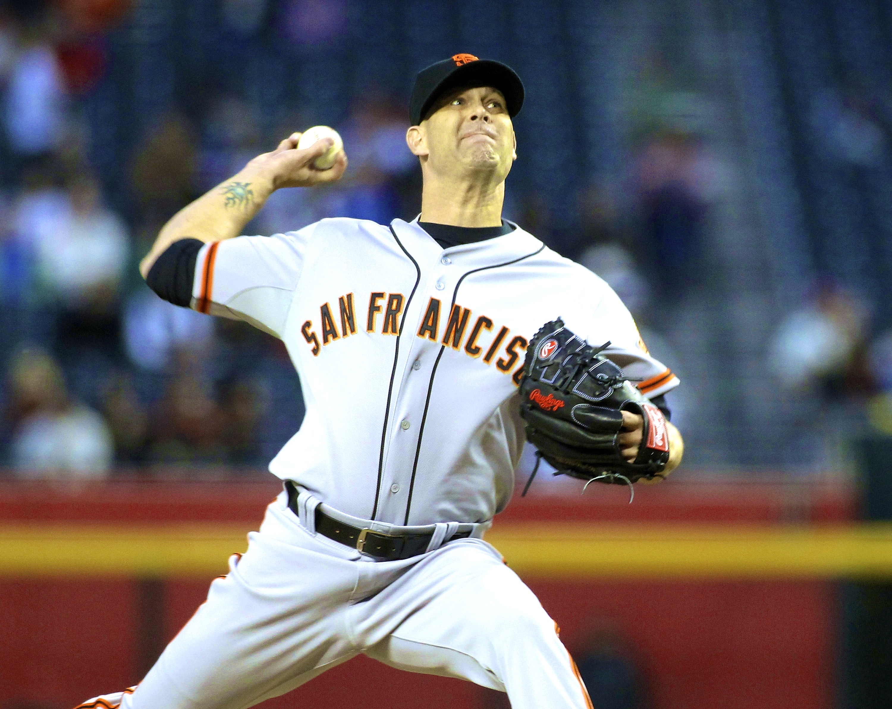 San Francisco Giants' Tim Hudson throws a pitch against the Arizona Diamondbacks during the first inning of a baseball game, Wednesday, April 2, 2014, in Phoenix. (AP Photo/Ross D. Franklin)