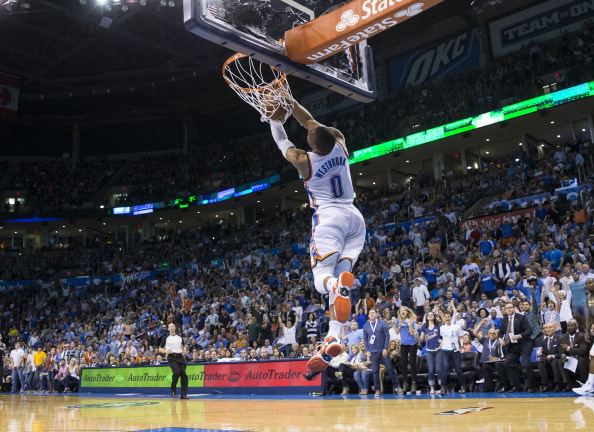 OKLAHOMA CITY, OK - April 3, 2014: Russell Westbrook #0 of the Oklahoma City Thunder dunks against the San Antonio Spurs at the Chesapeake Arena on April 3, 2014 in Oklahoma City, Oklahoma. NOTE TO USER:  User expressly acknowledges and agrees that, by downloading and/or using this photograph, user is consenting to the terms and conditions of the Getty Images License Agreement. Mandatory Copyright Notice:  Copyright 2014 NBAE (Photo by Richard Rowe/NBAE via Getty Images)