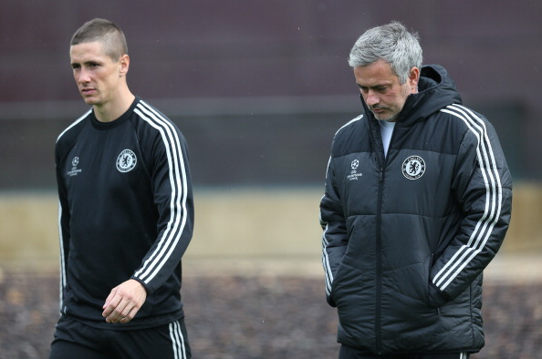 COBHAM, ENGLAND - OCTOBER 21: Chelsea manager Jose Mourinho chats with Fernando Torres during a Chelsea training session ahead of their UEFA Champions League Group E match against Schalke on October 21, 2013 in Cobham, England, (Photo by Charlie Crowhurst/Getty Images)