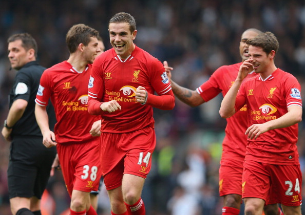 LIVERPOOL, ENGLAND - MARCH 30:  Jordan Henderson of Liverpool celebrates with his team-mates after scoring the fourth goal during the Barclays Premier League match between Liverpool and Tottenham Hotspur at Anfield on March 30, 2014 in Liverpool, England.  (Photo by Alex Livesey/Getty Images)