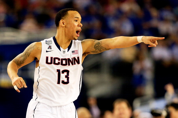 ARLINGTON, TX - APRIL 07: Shabazz Napier #13 of the Connecticut Huskies calls a play against the Kentucky Wildcats during the NCAA Men's Final Four Championship at AT&T Stadium on April 7, 2014 in Arlington, Texas.  (Photo by Jamie Squire/Getty Images)