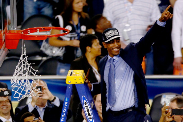 ARLINGTON, TX - APRIL 07:  Head coach Kevin Ollie of the Connecticut Huskies acknowledges the crowd after defeating the Kentucky Wildcats 60-54 in the NCAA Men's Final Four Championship at AT&T Stadium on April 7, 2014 in Arlington, Texas.  (Photo by Tom Pennington/Getty Images)