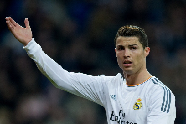 MADRID, SPAIN - JANUARY 09:  Cristiano Ronaldo of Real Madrid CF protests to the referee during the Copa del Rey Round of 8 first match between Real Madrid and CA Osasuna at Estadio Santiago Bernabeu on January 9, 2014 in Madrid, Spain.  (Photo by Gonzalo Arroyo Moreno/Getty Images)