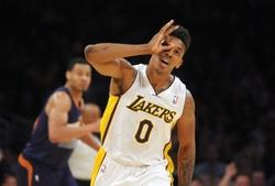 Mar 30, 2014; Los Angeles, CA, USA; Los Angeles Lakers guard Nick Young (0) celebrates after a 3-point basket against the Phoenix Suns at Staples Center. Mandatory Credit: Kirby Lee-USA TODAY Sports