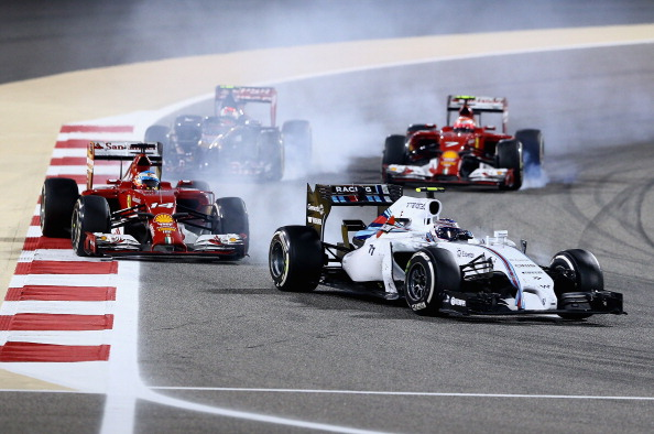 SAKHIR, BAHRAIN - APRIL 06:  Valtteri Bottas of Finland and Williams leads from Fernando Alonso of Spain and Ferrari during the Bahrain Formula One Grand Prix at the Bahrain International Circuit on April 6, 2014 in Sakhir, Bahrain.  (Photo by Clive Mason/Getty Images)