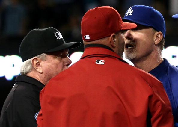 LOS ANGELES, CA - JUNE 11:  Batting coach Mark McGwire (R) of the Los Angeles Dodgers has words with manager Kirk Gibson of the Arizona Diamondbacks as first base umpire Brian Gorman intervenes during a bench clearing brawl in the seventh inning at Dodger Stadium on June 11, 2013 in Los Angeles,  (Photo by Stephen Dunn/Getty Images)