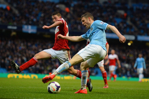 MANCHESTER, ENGLAND - MARCH 22:  Patrick Roberts of Fulham goes into block the cross from James Milner of Manchester City lduring the Barclays Premier League match between Manchester City and Fulham at Etihad Stadium on March 22, 2014 in Manchester, England.  (Photo by Michael Regan/Getty Images)