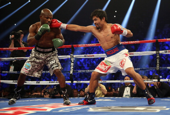 LAS VEGAS, NV - APRIL 12:  Manny Pacquiao lands a right hand to the head of Timothy Bradley at the MGM Grand Garden Arena on April 12, 2014 in Las Vegas, Nevada.  (Photo by Jeff Gross/Getty Images)