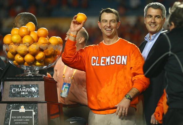MIAMI GARDENS, FL - JANUARY 03: Head coach Dabo Swinney of the Clemson Tigers holds up an orange after defeating the Ohio State Buckeyes during the Discover Orange Bowl at Sun Life Stadium on January 3, 2014 in Miami Gardens, Florida. Clemson defeated Ohio State 40-35. (Photo by Streeter Lecka/Getty Images)