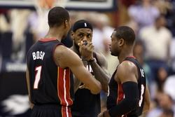 Dec 10, 2013; Indianapolis, IN, USA; Miami Heat forward LeBron James (6) talks to center Chris Bosh (1) and guard Dwayne Wade (3) during a game against the Indiana Pacers at Bankers Life Fieldhouse. Mandatory Credit: Brian Spurlock-USA TODAY Sports