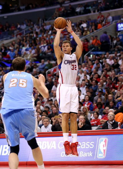 LOS ANGELES, CA - APRIL 15:  Blake Griffin #32 of the Los Angeles Clippers shoots over Timofey Mozgov #25 of the Denver Nuggets at Staples Center on April 15, 2014 in Los Angeles, California.  The Clippers won 117-105. NOTE TO USER: User expressly acknowledges and agrees that, by downloading and or using this photograph, User is consenting to the terms and conditions of the Getty Images License Agreement.  (Photo by Stephen Dunn/Getty Images)