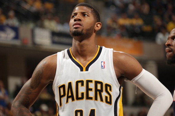 INDIANAPOLIS - APRIL 22  : Paul George #24 of the Indiana Pacers looks on against the Atlanta Hawks in the East Conference Quarter Finals Game Two at Bankers Life Fieldhouse on April 22 2014 in Indianapolis, Indiana.  NOTE TO USER: User expressly acknowledges and agrees that, by downloading and or using this Photograph, user is consenting to the terms and condition of the Getty Images License Agreement. Mandatory Copyright Notice: 2014 NBAE  (Photo by Ron Hoskins/NBAE via Getty Images)