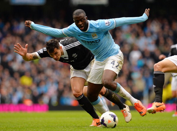 MANCHESTER, ENGLAND - APRIL 05:  Yaya Toure of Manchester City is challenged by Jose Fonte of Southampton during the Barclays Premier League match between Manchester City and Southampton at Etihad Stadium on April 5, 2014 in Manchester, England.  (Photo by Shaun Botterill/Getty Images)