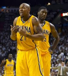 May 22, 2013; Miami, FL, USA; Indiana Pacers power forward David West (left) and center Roy Hibbert (right) react during the second half in game one of the Eastern Conference finals against the Miami Heat of the 2013 NBA Playoffs at American Airlines Arena. Miami wins in overtime 103-102. Mandatory Credit: Steve Mitchell-USA TODAY Sports
