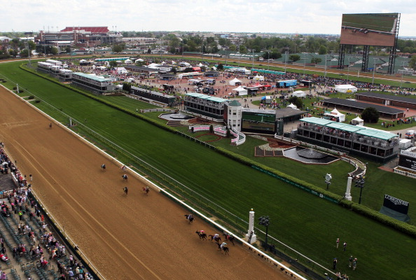 LOUISVILLE, KY - MAY 02:  Tiz Windy #2 leads Handmade #1 and Flipcup #3 across the finish line to win the 3rd race ahead of the 140th Kentucky Oaks at Churchill Downs on May 2, 2014 in Louisville, Kentucky.  (Photo by Jamie Squire/Getty Images)