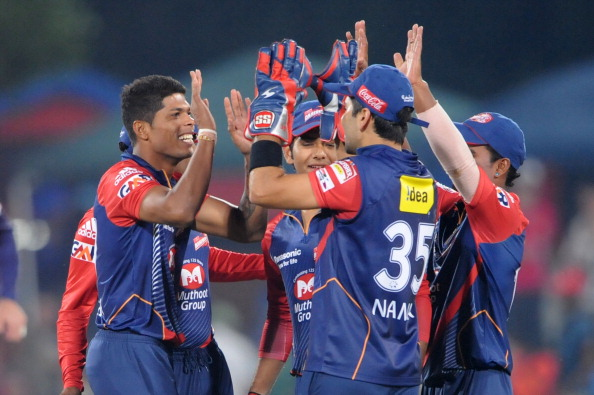 PRETORIA, SOUTH AFRCA - OCTOBER 13:  Umesh Yadav (L) of the Daredevils celebrateswith team-mates after capturing the wicket of Yusuf Pathan (not pictured) of the Knight Riders during the Karbonn Smart CLT20 match between Kolkata Knight Riders (IPL) and Delhi Daredevils (IPL) at SuperSport Park on October 13, 2012 in Pretoria, South Africa.  (Photo by Lee Warren/Gallo Images/Getty Images)