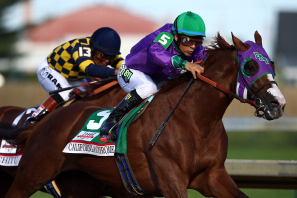LOUISVILLE, KY - MAY 03:  California Chrome #5, ridden by Victor Espinoza, comes out of the fourth turn enroute to winning the 140th running of the Kentucky Derby at Churchill Downs on May 3, 2014 in Louisville, Kentucky.  (Photo by Andy Lyons/Getty Images)
