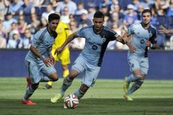 May 4, 2014; Kansas City, KS, USA; Sporting KC forward Dom Dwyer (14) controls the ball against the Columbus Crew during the second half at Sporting Park. Sporting KC defeats Columbus Crew 2-0. Mandatory Credit: Jasen Vinlove-USA TODAY Sports