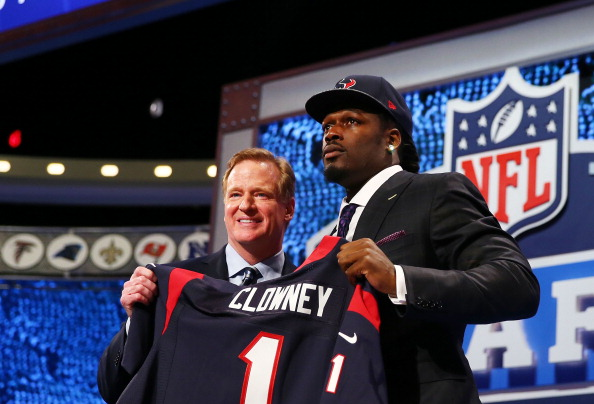 NEW YORK, NY - MAY 08:  Jadeveon Clowney of the South Carolina Gamecocks stands on stage with NFL Commissioner Roger Goodell after he was picked #1 overall by the Houston Texansduring the first round of the 2014 NFL Draft at Radio City Music Hall on May 8, 2014 in New York City.  (Photo by Elsa/Getty Images)