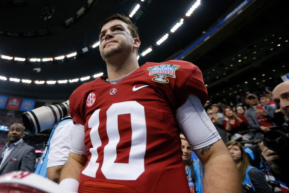 NEW ORLEANS, LA - JANUARY 02:  AJ McCarron #10 of the Alabama Crimson Tide walks off the field after the Allstate Sugar Bowl at the Mercedes-Benz Superdome on January 2, 2014 in New Orleans, Louisiana. The Sooners defeated the Crimson Tide 45-31.  (Photo by Kevin C. Cox/Getty Images)