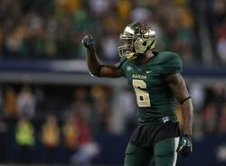 Nov 16, 2013; Arlington, TX, USA; Baylor Bears safety Ahmad Dixon (6) reacts to the sidelines during the game against the Texas Tech Red Raiders at AT&T Stadium. Mandatory Credit: Matthew Emmons-USA TODAY Sports
