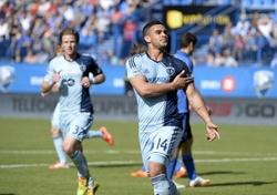 May 10, 2014; Montreal, Quebec, CAN; Sporting KC forward Dom Dwyer (14) reacts after scoring a goal against the Montreal Impact during the first half at Stade Saputo. Mandatory Credit: Eric Bolte-USA TODAY Sports