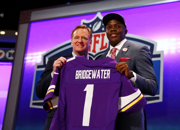 NEW YORK, NY - MAY 08:  Teddy Bridgewater of the Louisville Cardinals poses with NFL Commissioner Roger Goodell after he was picked #32 overall by the Minnesota Vikings during the first round of the 2014 NFL Draft at Radio City Music Hall on May 8, 2014 in New York City.  (Photo by Elsa/Getty Images)