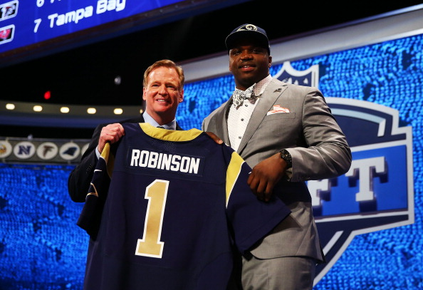 NEW YORK, NY - MAY 08:  Greg Robinson of the Auburn Tigers poses with NFL Commissioner Roger Goodell after he was picked #2 overall by the during the first round of the 2014 NFL Draft at Radio City Music Hall on May 8, 2014 in New York City.  (Photo by Elsa/Getty Images)