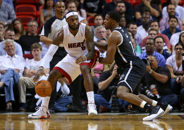 MIAMI, FL - MARCH 12:  LeBron James #6 of the Miami Heat posts up Joe Johnson #7 of the Brooklyn Nets during a game  at American Airlines Arena on March 12, 2014 in Miami, Florida. NOTE TO USER: User expressly acknowledges and agrees that, by downloading and/or using this photograph, user is consenting to the terms and conditions of the Getty Images License Agreement. Mandatory copyright notice:  (Photo by Mike Ehrmann/Getty Images)
