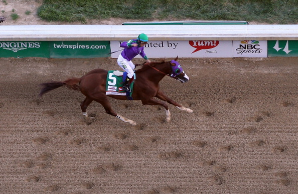 LOUISVILLE, KY - MAY 03:  California Chrome with Victor Espinoza up crosses the finish line to win the 140th running of the Kentucky Derby at Churchill Downs on May 3, 2014 in Louisville, Kentucky.  (Photo by Jamie Squire/Getty Images)