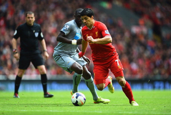 LIVERPOOL, ENGLAND - MAY 11:  Luis Suarez of Liverpool takes on Moussa Sissoko of Newcastle United during the Barclays Premier League match between Liverpool and Newcastle United at Anfield on May 11, 2014 in Liverpool, England.  (Photo by Laurence Griffiths/Getty Images)