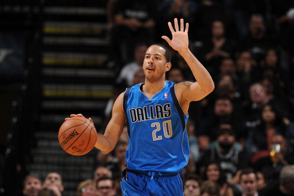 SAN ANTONIO, TX - APRIL 20: Devin Harris #20 of the Dallas Mavericks dribbles the ball during Game One of the Western Conference Quarterfinals during the 2014 NBA Playoffs against the San Antonio Spurs on April 20, 2014 at the AT&T Center in San Antonio, Texas. NOTE TO USER: User expressly acknowledges and agrees that, by downloading and/or using this Photograph, user is consenting to the terms and conditions of the Getty Images License Agreement. Mandatory Copyright Notice: Copyright 2013 NBAE (Photo by Garrett W. Ellwood/NBAE via Getty Images)