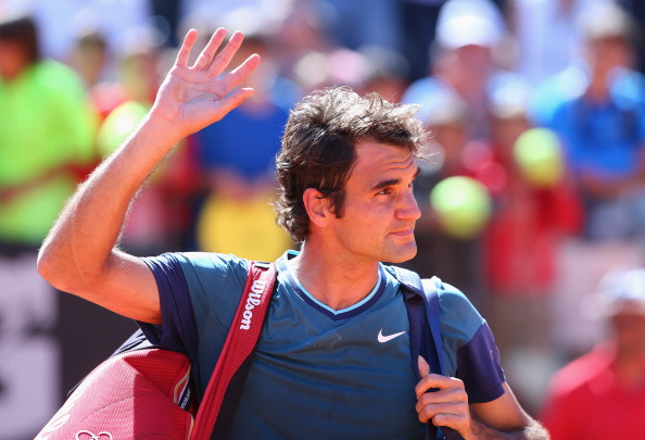 ROME, ITALY - MAY 14:  Roger Federer of Switzerland waves to the crowd after losing to Jeremy Chardy of France during day four of the Internazionali BNL d'Italia tennis 2014 on May 14, 2014 in Rome, Italy.  (Photo by Julian Finney/Getty Images)