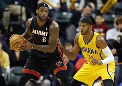 Dec 10, 2013; Indianapolis, IN, USA; Miami Heat  guard LeBron James (6) is guarded by Indiana Pacers forward Paul George (24) at Bankers Life Fieldhouse. Indiana defeats Miami 90-84. Mandatory Credit: Brian Spurlock-USA TODAY Sports