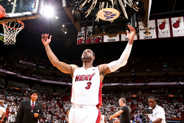 MIAMI, FL - MAY 14: Dwyane Wade #3 of the Miami Heat celebrates during a game against the Brooklyn Nets in Game Five of the Eastern Conference Semifinals of the 2014 NBA playoffs at American Airlines Arena in Miami, Florida on May 14, 2014.  NOTE TO USER: User expressly acknowledges and agrees that, by downloading and or using this photograph, User is consenting to the terms and conditions of the Getty Images License Agreement. Mandatory Copyright Notice: Copyright 2014 NBAE  (Photo by Nathaniel S. Butler/NBAE via Getty Images)