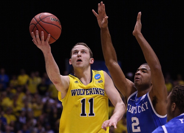 INDIANAPOLIS, IN - MARCH 30:  Nik Stauskas #11 of the Michigan Wolverines shoots the ball against Aaron Harrison #2 of the Kentucky Wildcats during the midwest regional final of the 2014 NCAA Men's Basketball Tournament at Lucas Oil Stadium on March 30, 2014 in Indianapolis, Indiana.  (Photo by Jonathan Daniel/Getty Images)