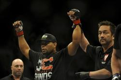 Feb 22, 2014; Las Vegas, NV, USA;  Daniel Cormier (red gloves) celebrates his victory of Pactrick Cummins (not pictured) after their UFC light heavyweight bout at Mandalay Bay. Cormier won by way of a TKO in the first round. Mandatory Credit: Stephen R. Sylvanie-USA TODAY Sports