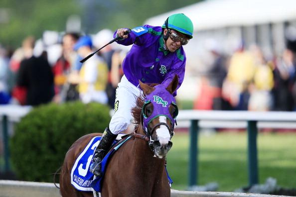 BALTIMORE, MD - MAY 17:  Victor Espinoza celebrates atop California Chrome #3 after winning the 139th running of the Preakness Stakes at Pimlico Race Course on May 17, 2014 in Baltimore, Maryland.  (Photo by Rob Carr/Getty Images)