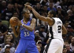 May 19, 2014; San Antonio, TX, USA; Oklahoma City Thunder forward Kevin Durant (35) is defended by San Antonio Spurs forward Kawhi Leonard (2) in game one of the Western Conference Finals in the 2014 NBA Playoffs at AT&T Center. The Spurs won 122-105. Mandatory Credit: Soobum Im-USA TODAY Sports