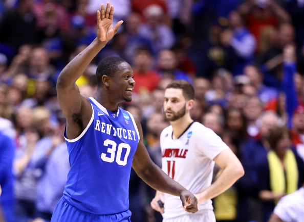 INDIANAPOLIS, IN - MARCH 28:  Julius Randle #30 of the Kentucky Wildcats celebrates defeating the Louisville Cardinals 74 to 69 during the regional semifinal of the 2014 NCAA Men's Basketball Tournament at Lucas Oil Stadium on March 28, 2014 in Indianapolis, Indiana.  (Photo by Andy Lyons/Getty Images)