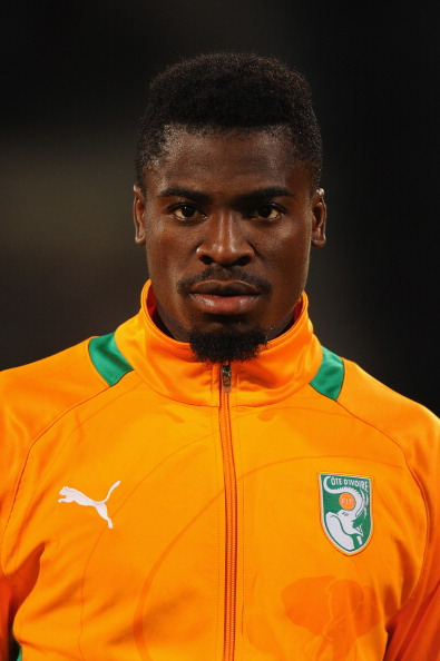CASABLANCA, MOROCCO - NOVEMBER 16:  Serge Aurier of Ivory Coast lines up for the National Anthem ahead of the FIFA 2014 World Cup Qualifier Play-off Second Leg between Senegal and Ivory Coast at Stade Mohammed V on November 16, 2013 in Casablanca, Morocco.  (Photo by Mike Hewitt/Getty Images)